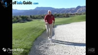 Downhill Lie With Raised Green Bunker Shot by Tom Stickney