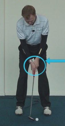 putt hands ahead of ball