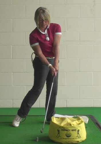 How To Use An Impact Bag To Create The Correct And Best Position For Women Golfers As They Strike The Golf Ball 1