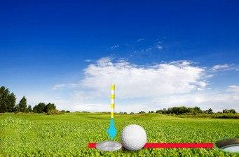 A golf ball on a fairway on a golf couse A