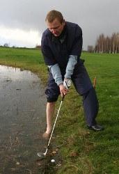Golfer strikes a golf shot